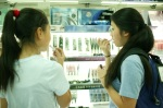 Vivian showing Shuming how to use makeup
